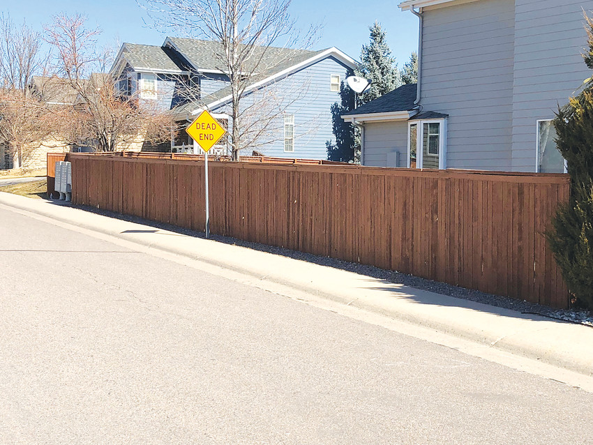 The Highlands Ranch Community Association is proposing a universal brown color for most private residential fences in the community. The change would be gradual, staff say. Residents who have recently re-stained their fences will not be required to immediately change the color.