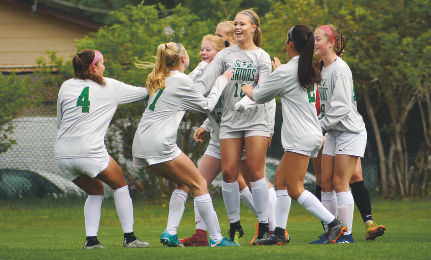 Standley Lake junior Haley Klasner (10) is mobbed by teammates after her first-half goal May 12 at Lakewood Memorial Field. Klasner had a goal and assist in the Gators' 2-1 victory over Lewis-Palmer in the second round of the s Class 4A girls soccer state playoffs.