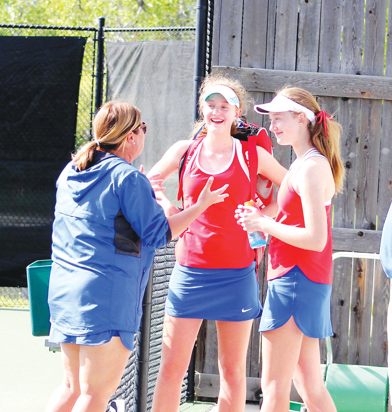 Cherry Creek coach Chris Jacob talks with freshman twins Nicole (center) and Eliza Hill after their semifinal matches at the Class 5A state tennis tournament on May 11 at the Gates Tennis Center.  Eliza won the No. 2 singles state championship and Nicole was the No. 3 single champ.