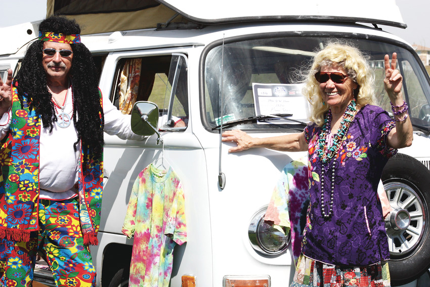 Participants dress up to show off their vintage VW Camper at 2016's Thornton Fest. The festival's car show is one popular part of the popular festival.