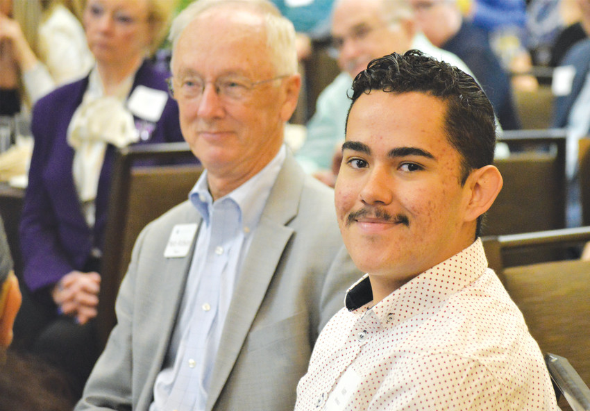 Young Citizen of the Year award winner Ivan Mendoza, flanked by Mayor Herb Atchison, smiles as his name is read during the May 11 Community Awards breakfast.