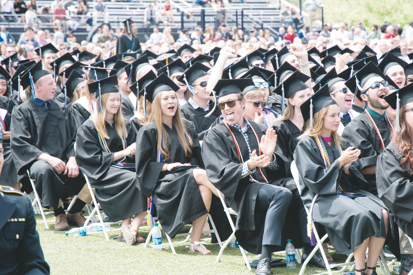 Colorado School of Mines undergraduate students applaud and celebrate each other's successes at their commencement ceremony on May 11 at Marv Kay Stadium on Mines campus in Golden.