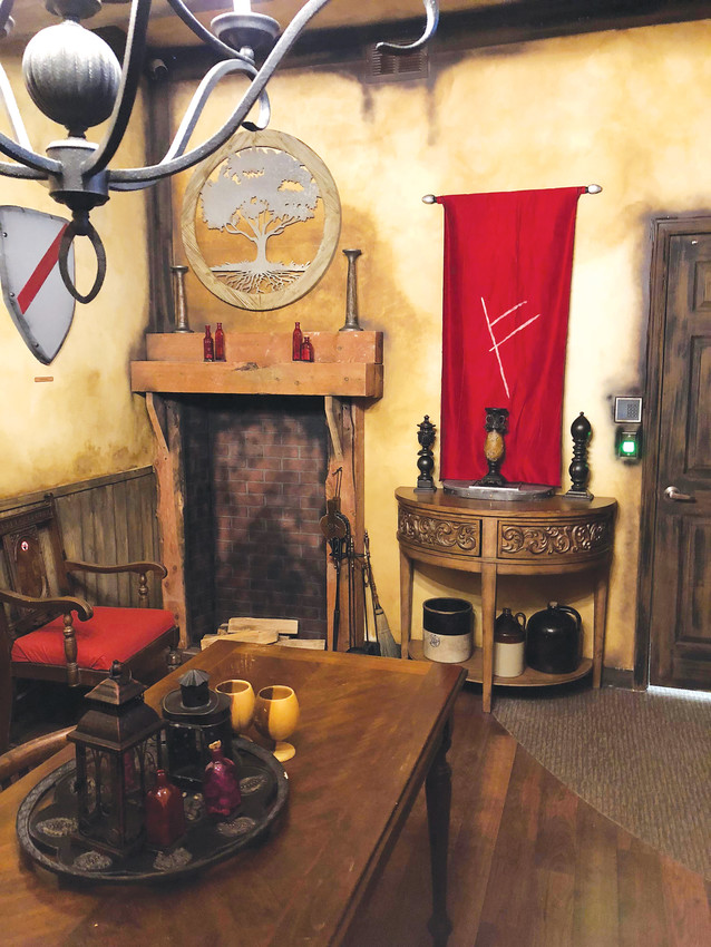 In one of the five games available at Castle Rock's escape room called The Quest, players can travel to The Middle Realm and battle an evil wizard.