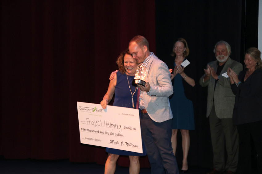 Community First Foundation President and CEO Marla Williams with Justin Kruger, the 2016 winner of the Innovator Society's first Pitch Showdown.