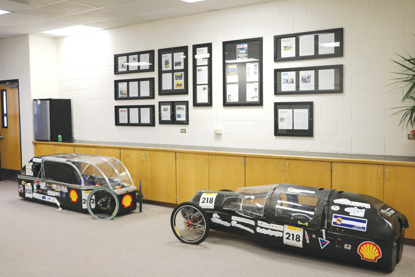 The Wheat Ridge STEM program's new conference room features the team's two first place winning prototype hydrogen fuel cell cars.