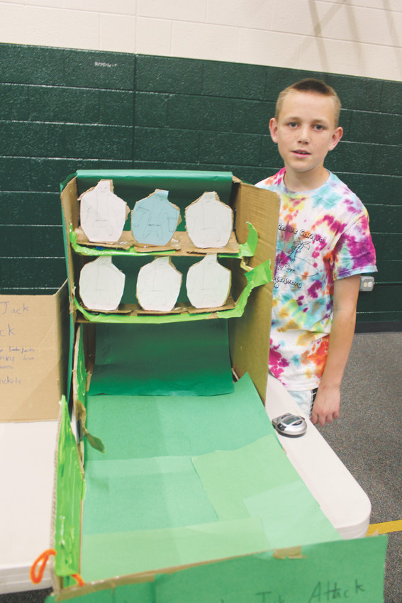 Finn Saunders, 11, shows off his Lumberjack Attack game at the Pine Lane Elementary carnival.