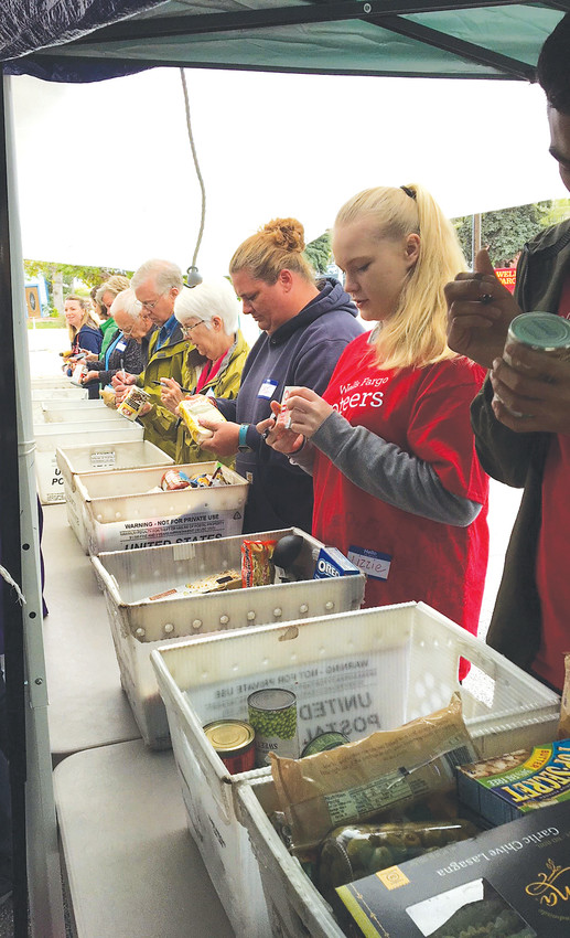 Volunteers sort food that was donated by Golden residents on May 12 for the 26th annual Letter Carriers' Stamp Out Hunger Food Drive.