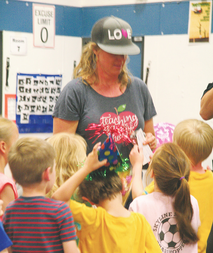 Kyffin Elementary School kindergartners congratulate their teacher, Jennie Clarke, on May 11 for being awarded the Golden Schools Foundation's Teacher Recognition Award.