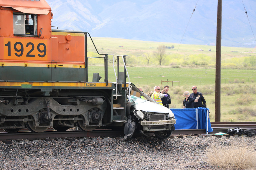 Two people were killed after a car and train collided at Highway 85, south of Ron King Trail on May 15.Photo by Alex DeWind