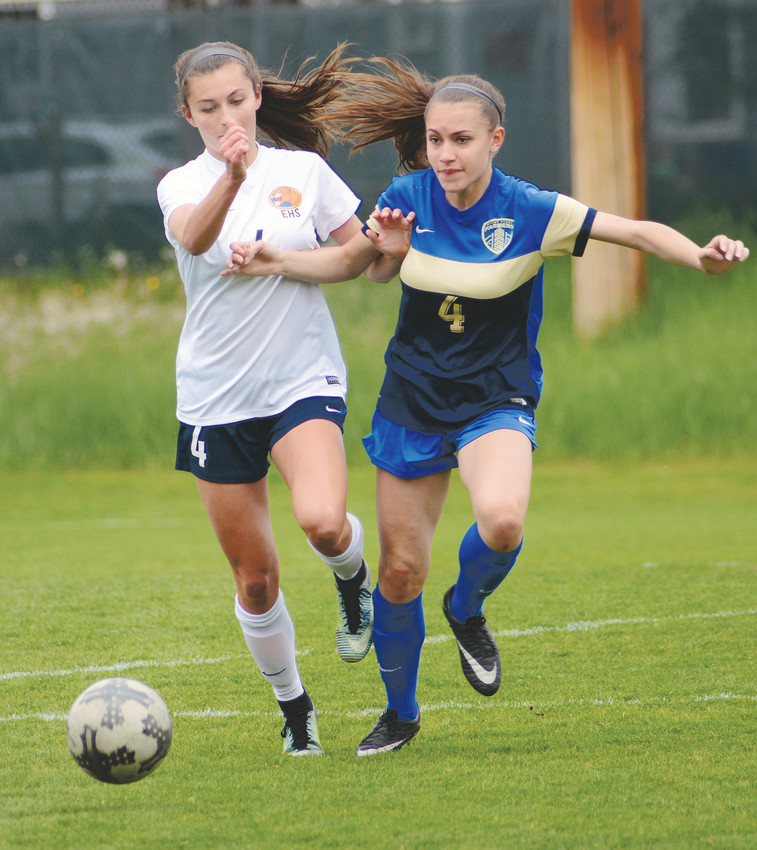 Wheat Ridge junior Paloma Rodello, right, battles with Evergreen freshman Jocelin Zimmerer during the first half May 12 at Lakewood Memorial Field. The Farmers suffered a 2-0 loss in the Class 4A state tournament second-round game to end their season.