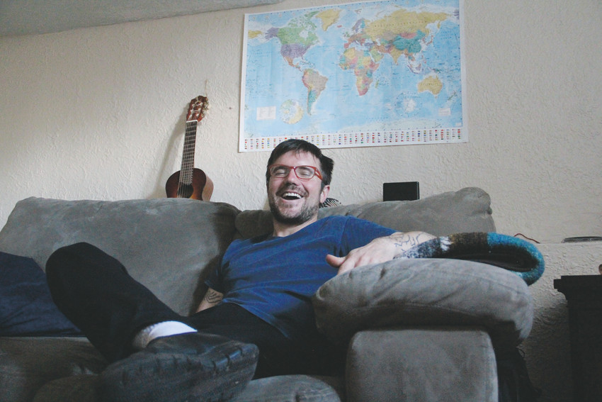 Adam Becker, who was homeless for more than a decade, sits in his new house just outside Englewood city limits.
