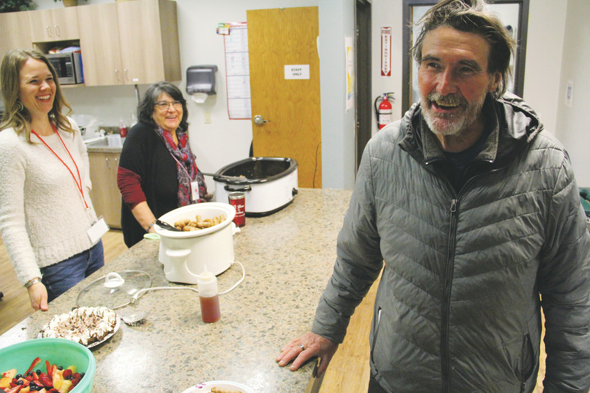 Greg Curtice, 60, laughs with Giving Heart volunteers as he gets lunch at the homeless-services center in Englewood April 24. Curtice, who is homeless and mostly stays in Englewood, stayed at motels on South Broadway in Englewood and slept in his van in a nearby church parking lot during a three-month stint of homelessness in late 2016. After a foreclosure on his Englewood home about four years ago, he said he lived with a friend but later got kicked out and eventually began staying in his van on and off.