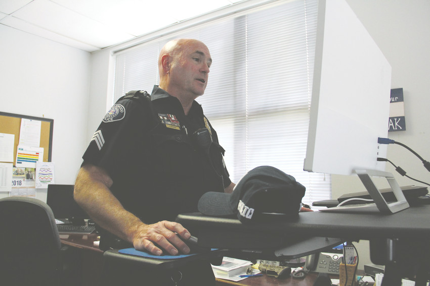 Englewood police Sgt. Reid McGrath, stands at his desk in his office April 25. Reid has been with the Englewood Police Department since 1992 and is a member of the Change the Trend Network, a coalition including nonprofits, churches and other entities working to address homelessness in Englewood.