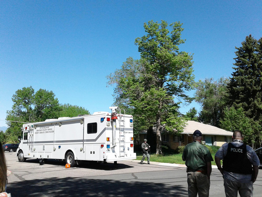 The Englewood police incident command vehicle is on scene where a barricaded man may be armed in the 4100 block of South Galapago Street on Wednesday morning, May 16.