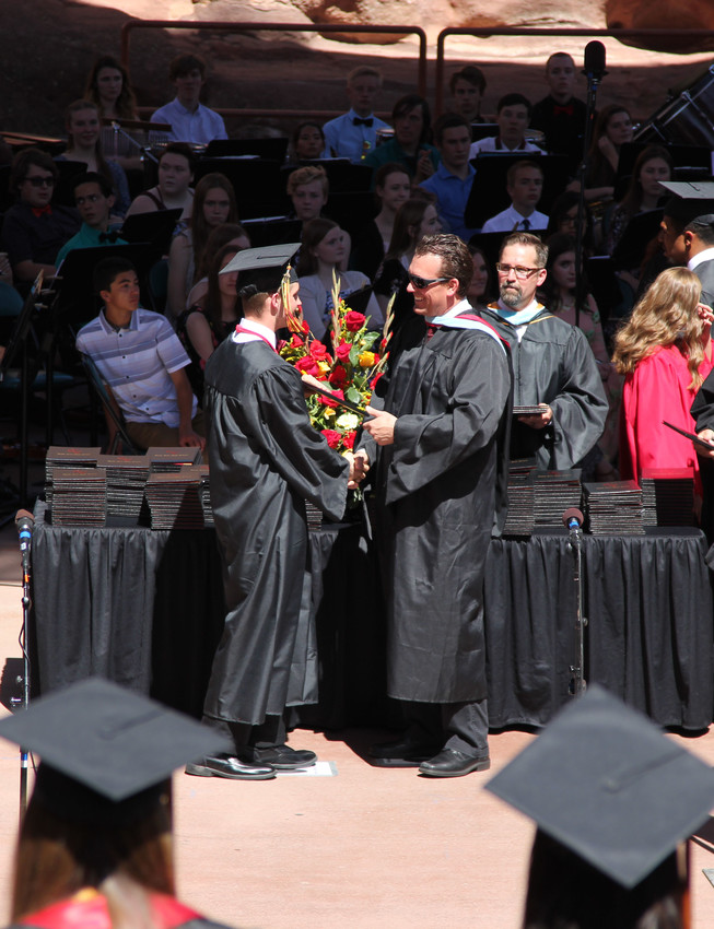 Assistant Principal Ryan Hollingshead steps in to hand out a diploma May 16.