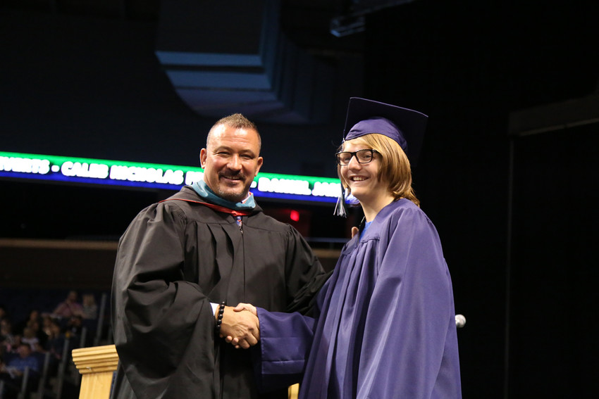 Graduate Bradley Beston shakes hands with Standley Lake High Principal Jeff Pierson.
