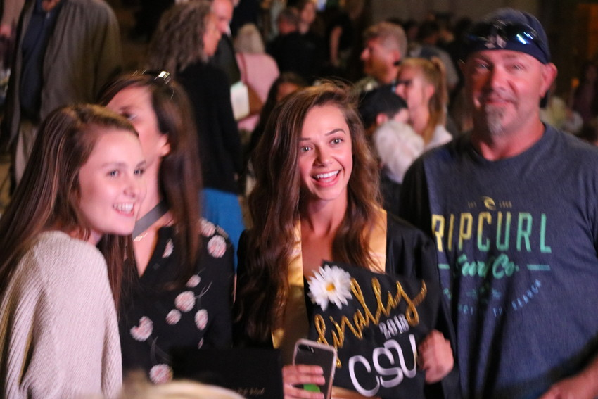 Green Mountain student Haylie Johnson celebrates her graduation with her family following the ceremony at Red Rocks on May 17.