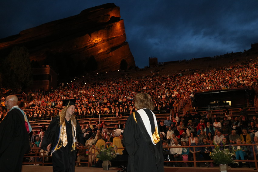 Green Mountain graduates receive a diploma and a hug from Principal Colleen Owens at Red Rocks on May 17.