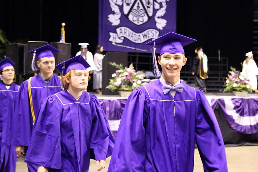 Trevor Cook enters the Arvada West High School graduation May 18 at 1st Bank Center in Broomfield.