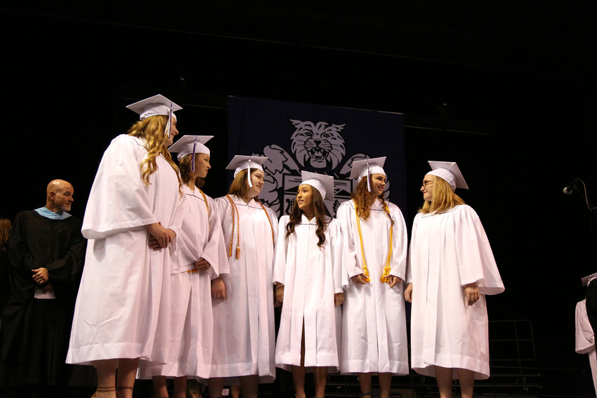 Graduates Nicole Ahrens, Isabella Cline, Avery Henderson, Taylor Huntley, Alexis Rolfson and Jenna Shed sang the national anthem at the beginning of the Arvada West High graduation.