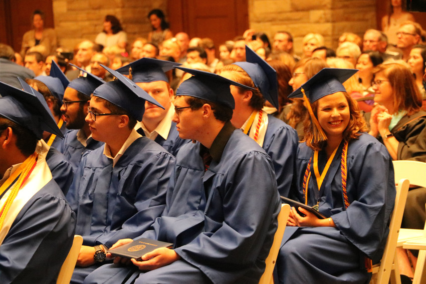 Graduates of STEM School Highlands Ranch listen to speakers at the May 18 commencement ceremony, often smiling or laughing. The graduation was held at the University of Colorado South Denver campus, 10035 S Peoria St. in Parker.