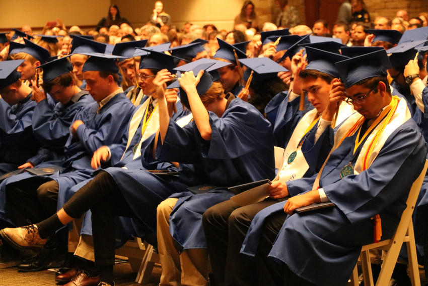 STEM School Highlands Ranch graduates close out their May 18 commencement ceremony by moving their tassels from the right to left side. The ceremony for the largest graduating class to date was held at University of Colorado South Denver in Parker.