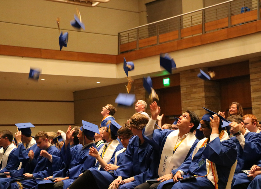 Graduates of STEM School Highlands Ranch toss their caps to close their May 18 graduation ceremony at University of Colorado South Denver in Parker. The class of 2018 was the largest graduating class to date.