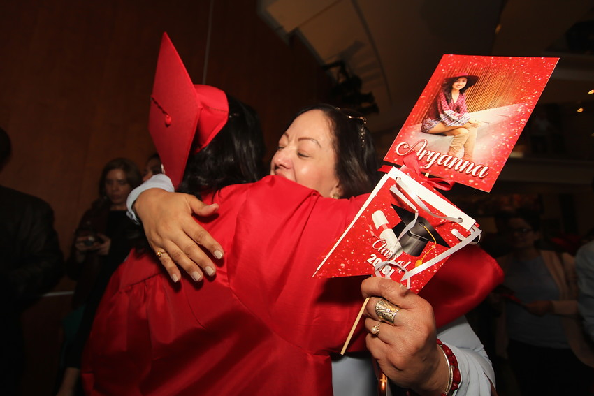 Arvada High School 2018 graduate Aryanna Lamas embraces obvoious fan Maria Madera.