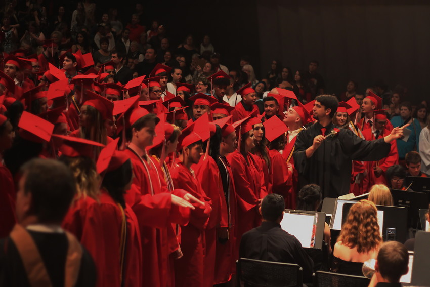 Arvada High School's Class of 2018 gather in the Ellie Caulkins theater for their graduation ceremony, May 18.