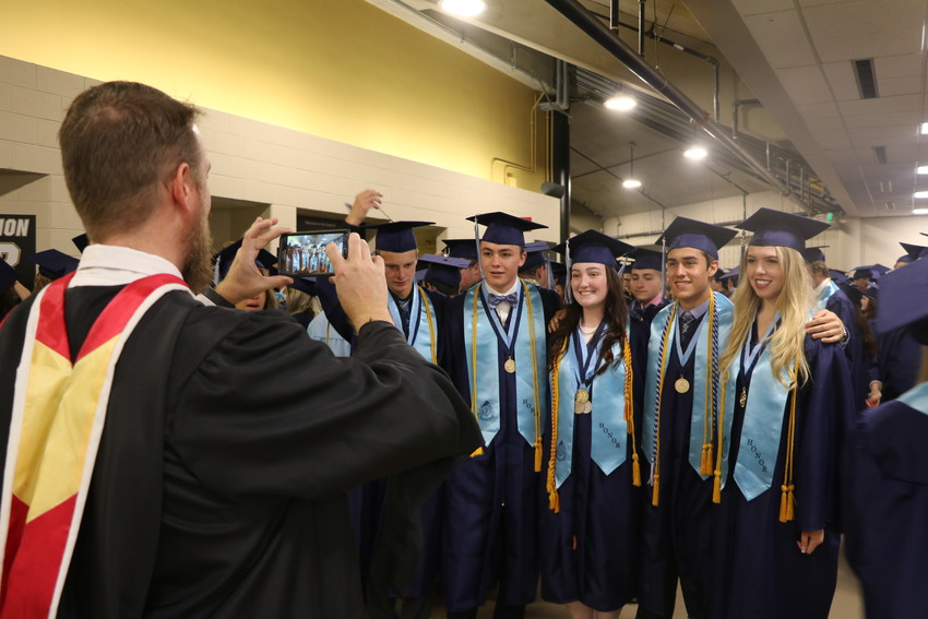 Before the graduation ceremony begins on May 18, Ralston Valley students pose for one last photo as seniors.