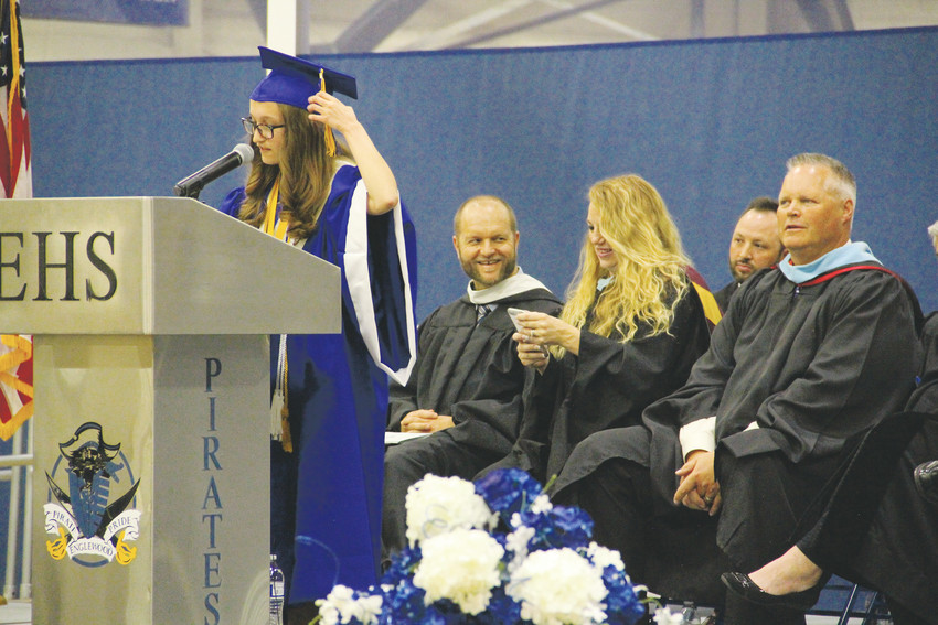 Haley Eickmann, also a valedictorian, gives closing remarks at Englewood High School's graduation ceremony May 19 after the awarding of diplomas. Eickmann led the class in the traditional moving of the cap tassels from one side to the other to signify officially graduating.