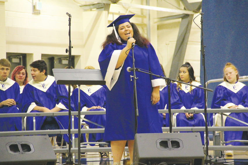 "Aliah Pater sings Fleetwood Mac's 1970s hit ""Landslide"" at Englewood High School's graduation ceremony May 19. Pater also sang with the EHS Vocal Groups at the ceremony."