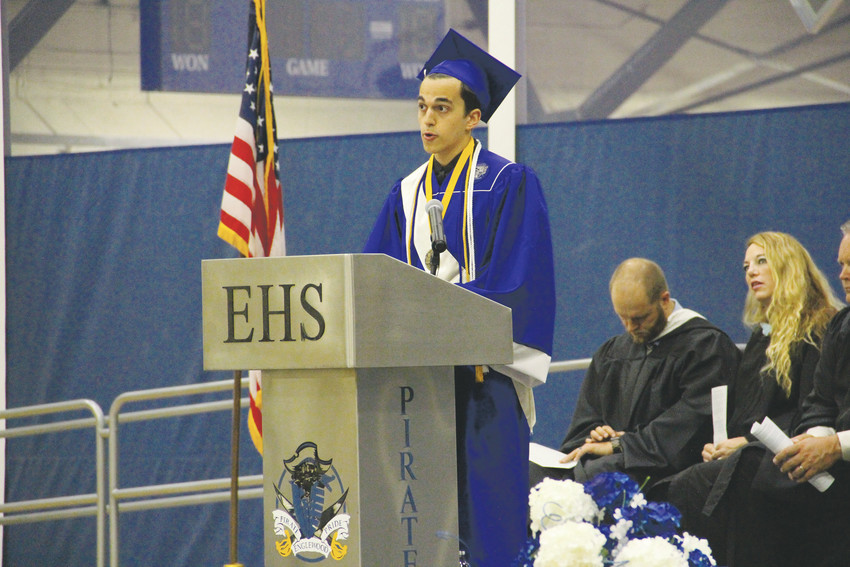 "Daniel Martins, a valedictorian, speaks to seniors at the Englewood High School graduation ceremony May 19 in an address that discussed facing fears. ""There is no voyage without a storm,"" Martins said."