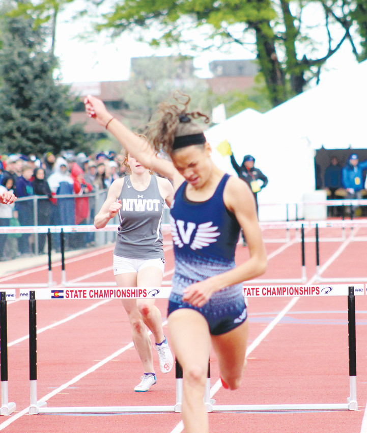 Valor Christian junior Anna Hall raises her hand after winning the Class 4A 300 hurdles on May 19 at the State high school track championships held at Jeffco Stadium. Hall also won the 100 hurdles and long jump and Valor Christian captured the 4A team title.
