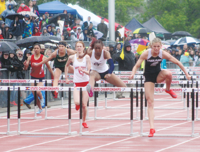 Rock Canyon's Emily Sloan, right, wins her fourth straight 100-meter hurdles title at the state high school track championships held May 17-19 at Jeffco Stadium. Sloan also won the 300 hurdles.
