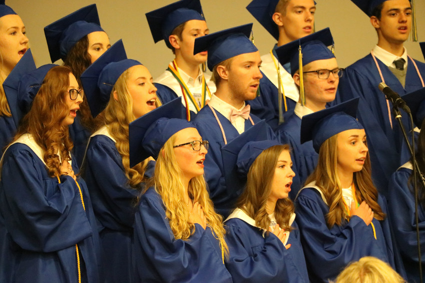 Graduates of SkyView Academy belt out melodic tunes at the 2018 graduation ceremony on May 19 in the gymnasium of the school, 6161 Business Center Dr.