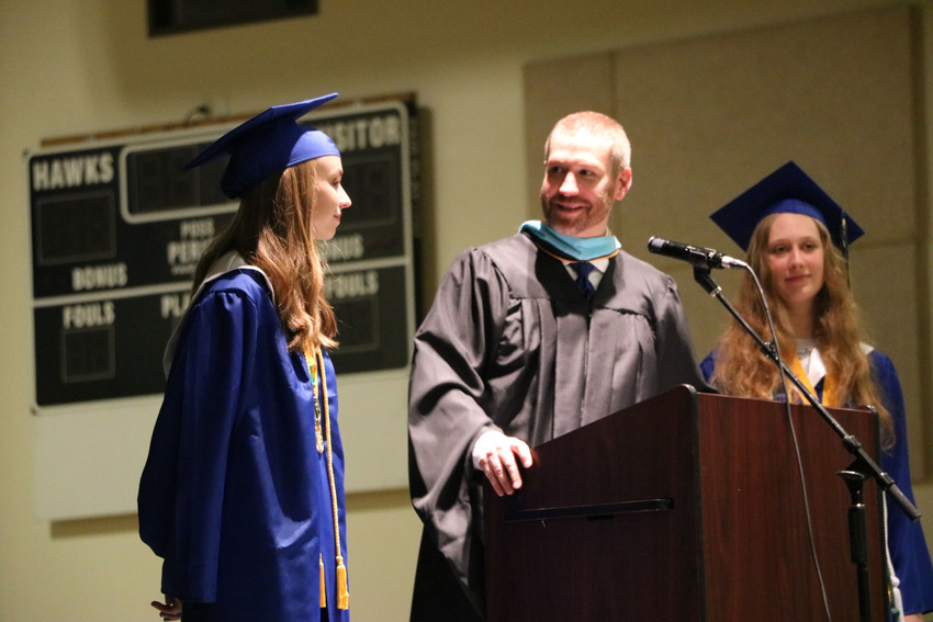 SkyView Academy principal Jon Ail honors salutatorians Mara Dalta and Laura Schoenhals at the May 19 graduation ceremony held in the gym of the school, 6161 Business Center Dr.