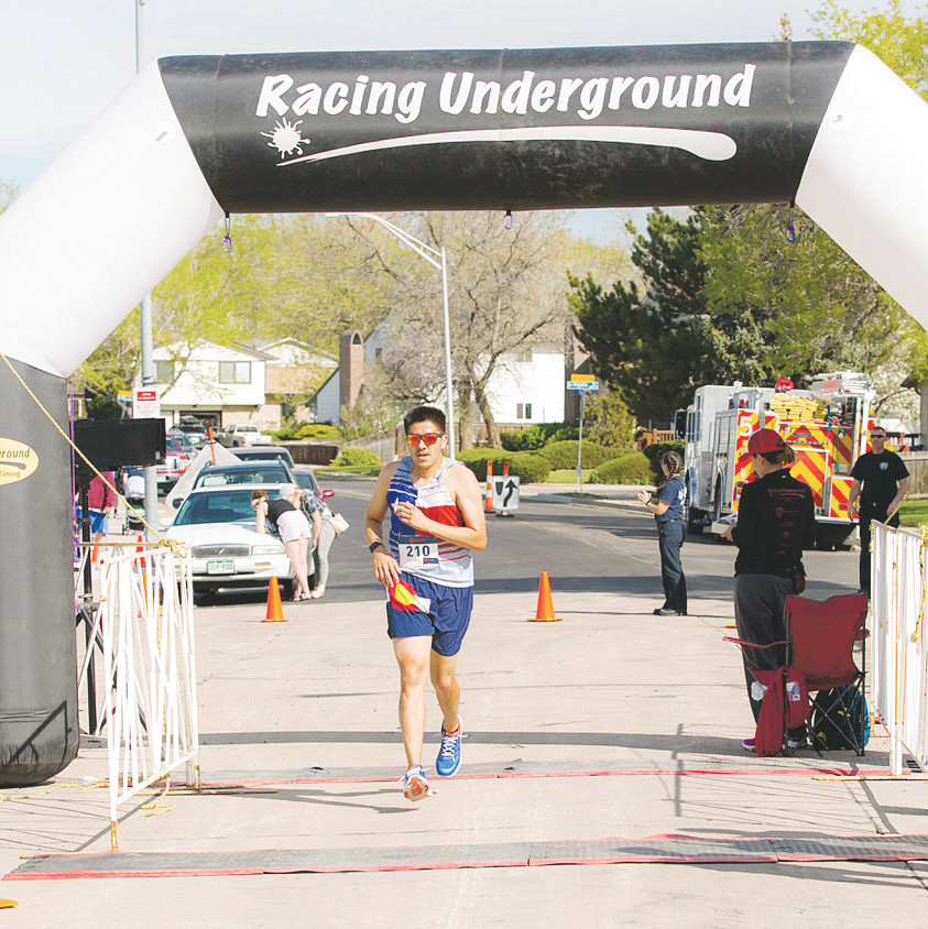 Overall winner Lenny Archuleta crossed the finish line with a time of 19:13.