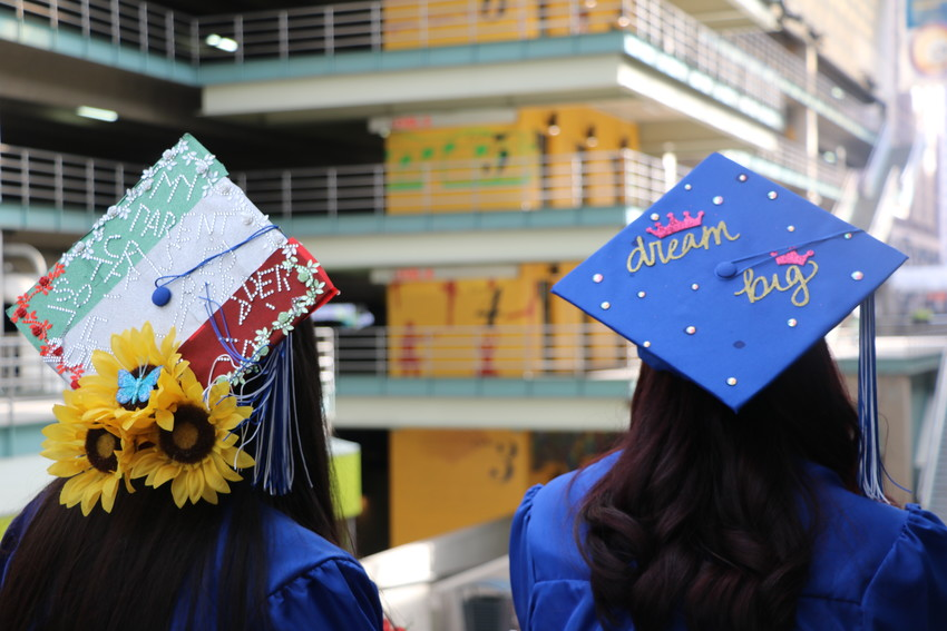 Alameda International High School celebrated the graduation of its 70th class of students with personalized mortarboard hats at the Buell Theatre on May 22.