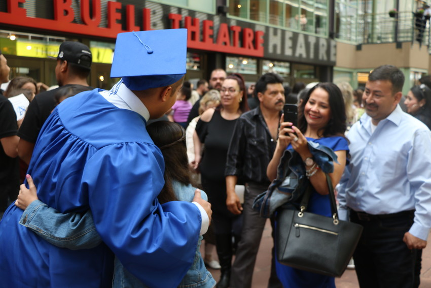 Alameda International High School graduates pose for photos at the Buelle Theatre following the ceremony on May 22.