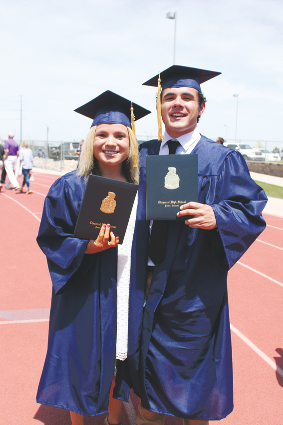 Twins Siearra and Hunter Rowe show off their diplomas after graduating from Chaparral High.