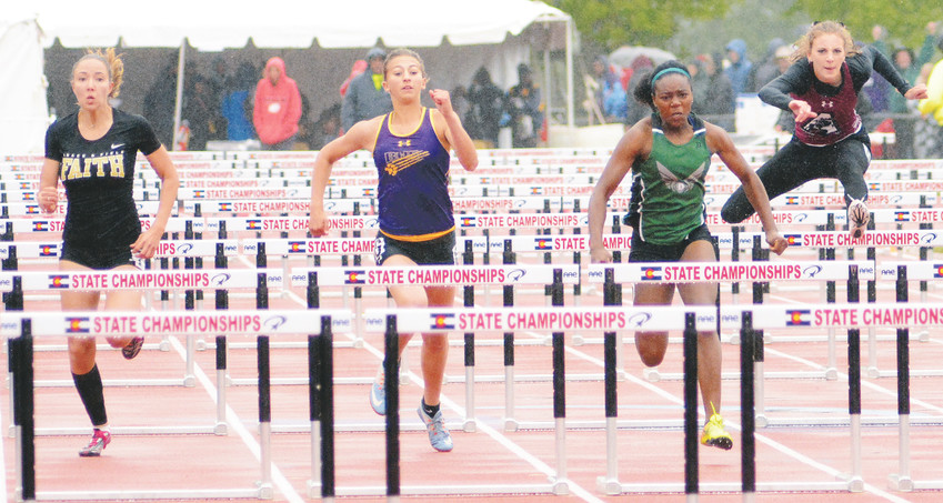 D'Evelyn junior Esther Diza-mbelolo, center, leads the Class 3A girls 100-meter hurdles state championship final in the rain May 19 at Jeffco Stadium. Diza-mbelolo won the race in a time of 15.08 seconds. She also placed on the podium in the 100, 200 and 300 hurdles.