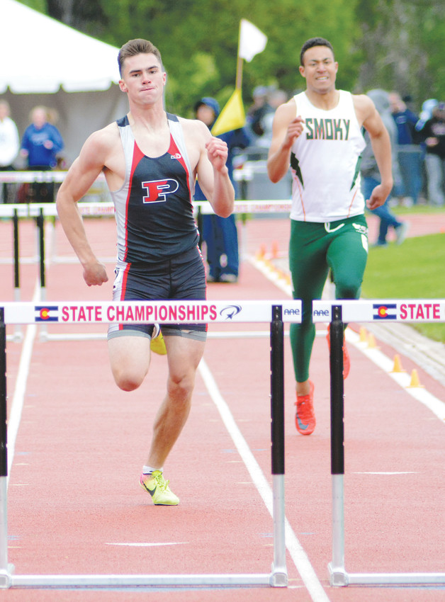 Pomona senior Ryan Marquez, left, runs in his final athlete event — Class 5A boys 300-meter hurdles — of his stellar high school career on May 19 at Jeffco Stadium. Marquez finished second in the race before he heads to play football at the University of Wyoming next fall.