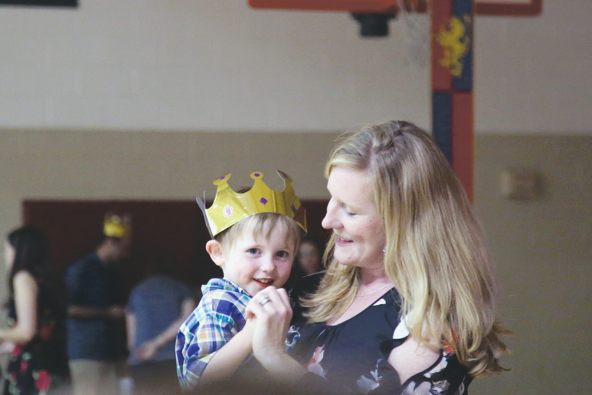 Kathleen Lamb dances with her son, Chirs, 3, at the Mom and Son Date Knight at the Arvada YMCA May 18.