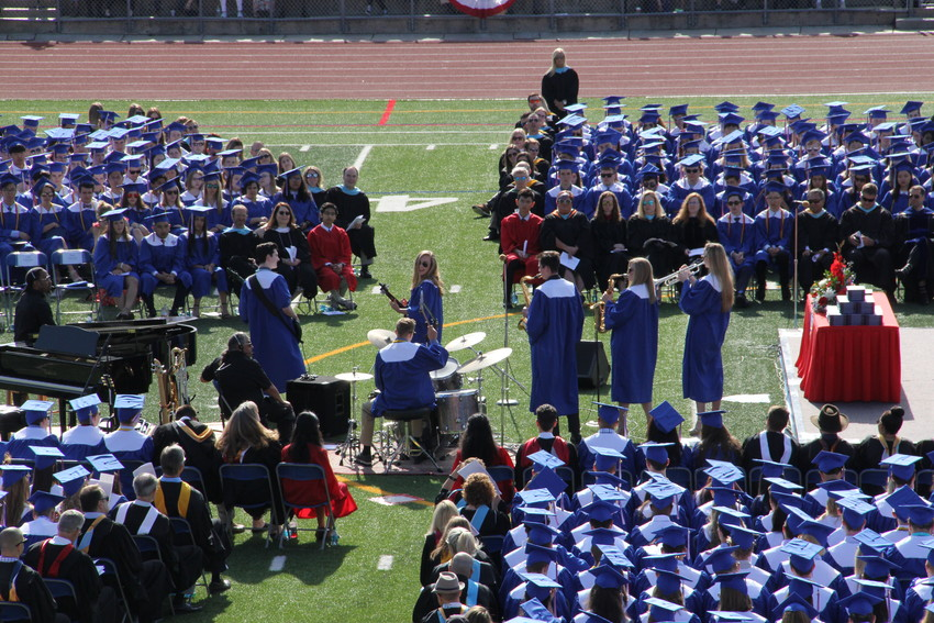 "A group of students performs Stevie Wonder's ""I Wish"" at Cherry Creek High School's graduation ceremony May 23. The number was one of four songs performed at the event."