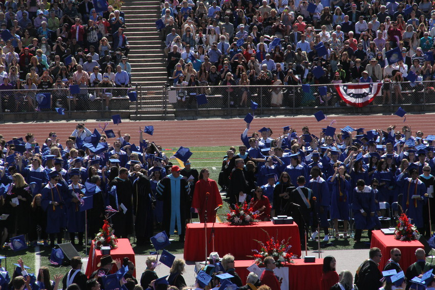 Students toss their caps in the air at the end of Cherry Creek High School's graduation ceremony May 23. Speakers said 834 students were in the graduating class.