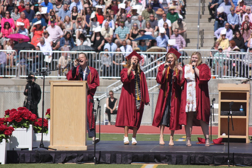 "Solei Daniels, Desirae Martz, Cassidy Pitts and Meredith Shepard entertained the crowd with a spirited rendition of ""Best Day of My Life"" during the Ponderosa High commencement ceremony May 23. Photo by Tabatha Stewart."