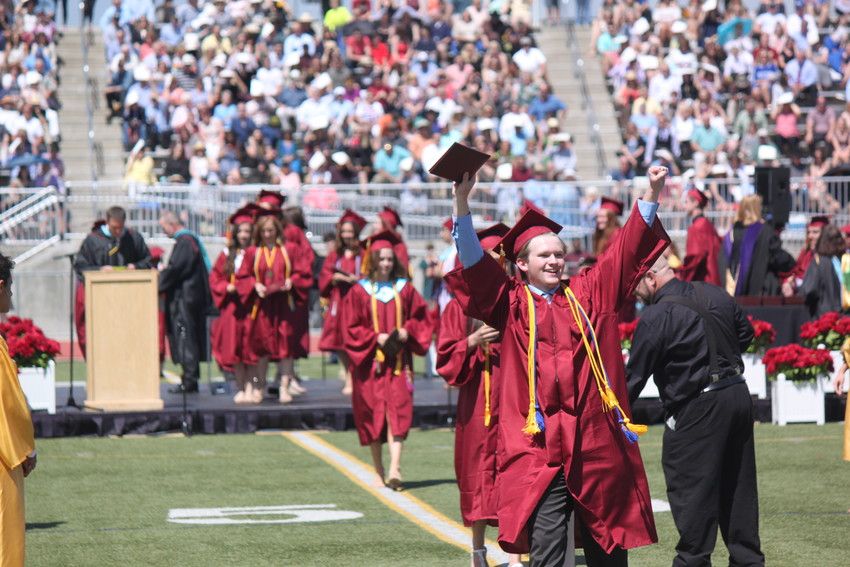 Each student had their own way of showing their excitement as they received their diplomas. Photo by Tabatha Stewart.