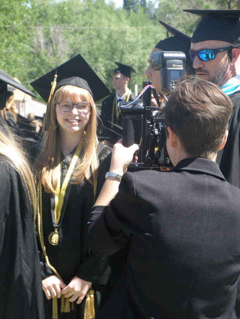 Peyton Smith gets her picture snapped moments before receiving her diploma.