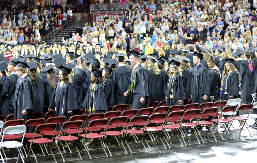 Graduates of Rock Canyon High School take their seats at the May 26 graduation ceremony at the University of Denver Magness Arena, 2250 E Jewell Ave.